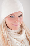 Young pretty winter woman in knit scarf and hat Royalty Free Stock Images