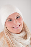 Young pretty winter woman in knit scarf and hat Stock Images