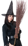 Young pretty witch Stock Images