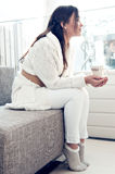 Young pretty woman. Drinking hot chocolate Royalty Free Stock Photos