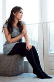 Young pretty woman. Sitting on couch Stock Photos