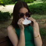 Young pretty woman, allergy, warm weather. Woman allergy young nose sneeze flu pretty Stock Images