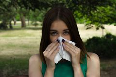Young pretty woman, allergy, warm weather. Woman allergy young nose sneeze flu pretty Stock Photos