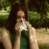 Young pretty woman, allergy, warm weather. Woman allergy young nose sneeze flu pretty Royalty Free Stock Photo