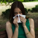 Young pretty woman, allergy, warm weather. Woman allergy young nose sneeze flu pretty Royalty Free Stock Photography