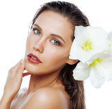 Young pretty woman with  Amarilis flower close up. Isolated on white, hands manicure Royalty Free Stock Photo