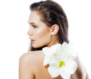 Young pretty woman with  Amarilis flower close up Stock Image