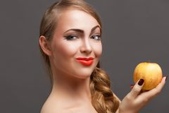 Young pretty woman with apple Royalty Free Stock Images