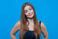 Young pretty woman with astonished smile, blue eyes. Funny face. royalty free stock image