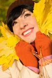Young pretty woman on the autumn leaf Royalty Free Stock Images