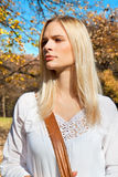 Young pretty woman at the autumn park. Stock Image