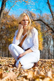 Young pretty woman at the autumn park. Royalty Free Stock Photography
