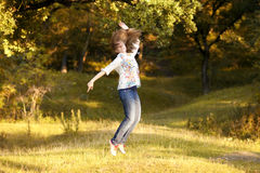 Young pretty woman in the autumn park Royalty Free Stock Photos