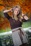 Young pretty woman at the autumn park Royalty Free Stock Images