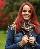 Young pretty woman in the autumn park Stock Photography
