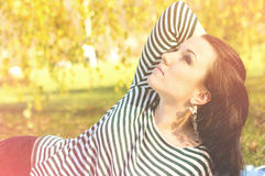 Young pretty woman in autumn park young. Royalty Free Stock Photos