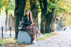 Young pretty woman at the autumn park. stock photo