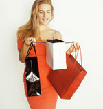 Young pretty woman with bags on Christmas sale in. Young pretty blond woman with bags on Christmas sale in red dress isolated white Stock Images
