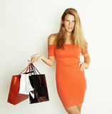Young pretty woman with bags on Christmas sale in Royalty Free Stock Photos