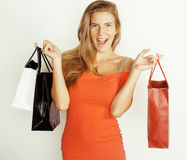 Young pretty woman with bags on Christmas sale in. Young pretty blond woman with bags on Christmas sale in red dress isolated white Royalty Free Stock Photo