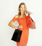 Young pretty woman with bags on Christmas sale in Royalty Free Stock Images