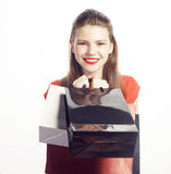 Young pretty woman with bags on Christmas sale in Stock Image