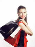 Young pretty woman with bags on Christmas sale in Stock Photo