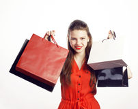 Young pretty woman with bags on Christmas sale in. Red dress isolated white Royalty Free Stock Image