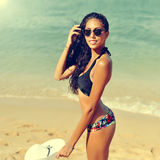Young pretty woman on a beach Stock Image