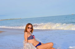Young Pretty Woman with beautiful body Relaxing On Sand At Beach Royalty Free Stock Photos