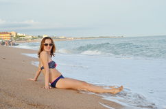 Young Pretty Woman with beautiful body Relaxing On Sand At Beach Royalty Free Stock Images