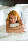 Young pretty woman in bed Royalty Free Stock Photo