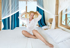 Young pretty woman in bed Stock Photography