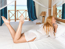 Young pretty woman in bed Royalty Free Stock Photography