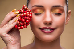The young pretty woman with berries in beauty concept Royalty Free Stock Images