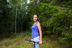 Young pretty woman and bicycle Stock Photography