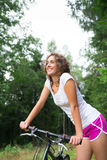 Young pretty woman and bicycle Royalty Free Stock Image
