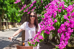 Young pretty woman on bicycle in summmer vacation Stock Image