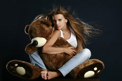Young pretty woman with big teddy bear Stock Image