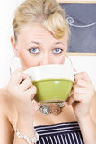 Attractive blonde woman drinking green tea Royalty Free Stock Photo
