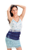 Young pretty woman in blue fringed sun-dress Stock Image