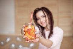 Young pretty woman holding mason jar with lemonade. royalty free stock photography