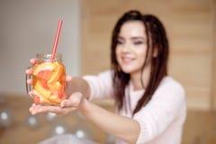 Young pretty woman holding mason jar with lemonade. royalty free stock photos