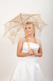 Young pretty woman bride with lace umbrella Stock Photo