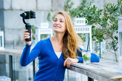 Young pretty woman broadcast live video Royalty Free Stock Photography