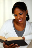 Young pretty woman browsing a book Royalty Free Stock Image