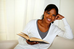 Young pretty woman browsing a book Royalty Free Stock Photo