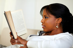 Young pretty woman browsing a book Stock Photography