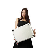Young pretty woman with case in hands. Young pretty brunette woman in black dress with silver white attache case in hands stands isolated on white background in stock images