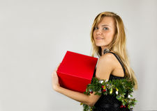 Young pretty woman with Christmas box Royalty Free Stock Image